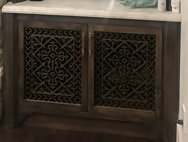 Custom cabinet doors with Arts and Crafts style decorative grilles.